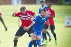 FOCUSED: Jordan Culpepper, right, battles for the ball against Franklin United. PHOTO: ANDREW WARNER