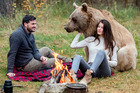 New Zealand man Osten, 35 and his girlfiend Anna, 22 camping with Stepan the bear. Photo / Caters News Agency