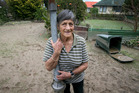 Joan Newdick, pictured in the mud in the backyard of her Edgecumbe home. Photo / Alan Gibson