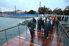 A crowd is taken out onto the new pier as part of Tauranga's revamped waterfront in a rainy, early morning blessing of the site. Photo/John Borren