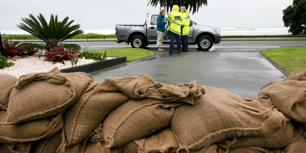 Loading Police going door to door in Ohope this afternoon telling residents they have to evacuate. Photo / Alan Gibson