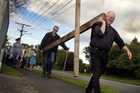 Father Peter Brockhill and Paul Czepanski lead the march of the cross along Pukepapa Rd in Marton. Photo/ Stuart Munro