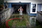 Heather Kupa in her flooded Arataki Home. Photograph: Andrew Warner