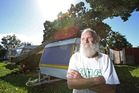 David Davis got the shock of his life when a tree fell on his rented caravan during Cyclone Cook but remained in his home on wheels for the night. Photo/John Borren