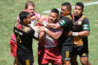 Chief players hold back Taniela Tupou after he headbutt Liam Messam. Quarter Final. Chiefs v Reds. Day 2. Brisbane Global Rugby Tens. Photo / Photosport.co.nz