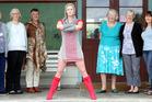 Nadine Corcoran (centre) with co-creators Andrea Penny (left), Rachel Hays, Beth Beale, Karen Workman, Pam MacLaughlan, Jennie Harris, Gaye McLeod and Janice Hird.