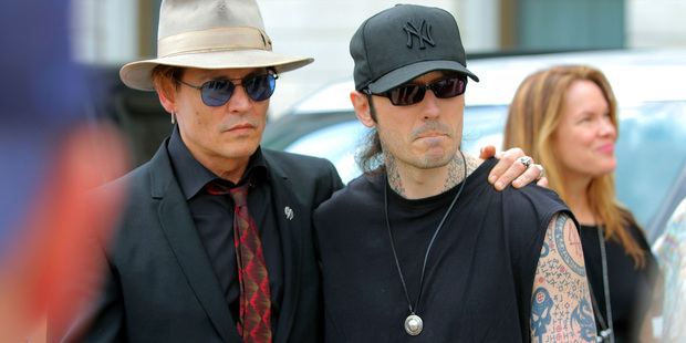 Actor Johnny Depp, left, stands with former Arkansas death row inmate Damien Echols, before speaking at a rally opposing Arkansas' upcoming executions. Photo / AP
