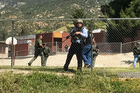 Emergency personnel respond to a shooting inside North Park Elementary School. Photo / AP