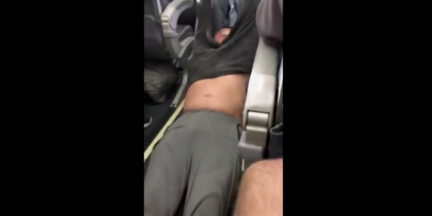 Footage of David Dao being dragged from a Uinted Airlines plane. Photo / AP