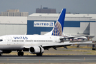 The contract included with every United ticket suggests it in fact breached its contract. Photo / AP