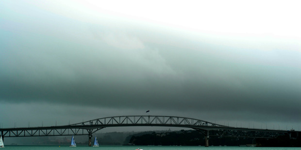 Loading The Auckland Harbour Bridge may close if winds strengthen today. Photo / File