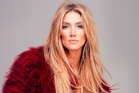 Delta Goodrem's dealing with some tension on the set of House Husbands. Photo / Supplied