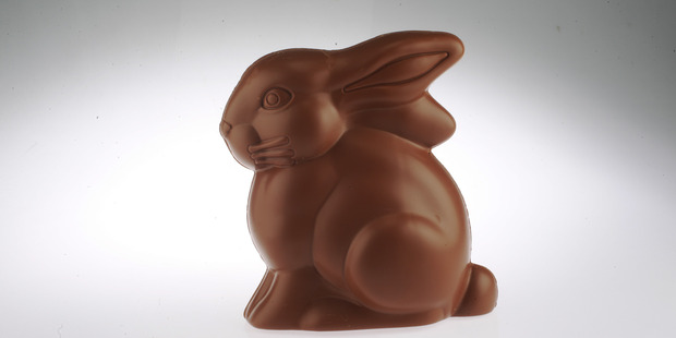 Most chocolate lovers tend to eat their Easter bunnies from the ears down, researchers say. Photo / File