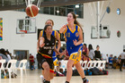 TOP CLASS: Action from last year's game between Tauranga and Waikato at the Mel Young Easter Basketball Classic tournament. PHOTO: File