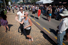 People enjoy dancing in the street at last year's Jazz Festival Downtown Carnival on The Strand, which will still go ahead this year despite Cyclone Cook. Photo/file