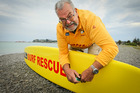 Westshore Surf Lifesaving Club's senior lifeguard instructor Brian Quirk works on a new donated board. Brian Quirk has given 50 years of service. 15 December 2016 Hawke's Bay Today photograph by Warre