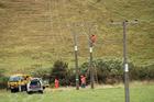 Top Energy linemen at work near Haruru Falls. Photo / Peter de Graaf