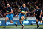 Sonny Bill Williams of the Blues makes a break during the round seven Super Rugby match between the Highlanders and the Blues. Photo / Getty Images.
