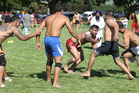 Ambu Padda from Auckland's Kalgidhar club (in red) tries to touch a member of the opposite team at the Hastings Kabaddi Cup 2017. Photo/ Warren Buckland.