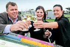 Hawke's Bay A & P Society president Richard Chambers, left, events manager Anna Hamilton and Mell Anderson toast the new format for this year's show in October. Photo/Duncan Brown