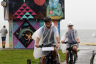 Peter and Charmaine Jensen from Queensland, Australia, cycling in light rain at Perfume Point in Napier yesterday. Photo/ Paul Taylor.