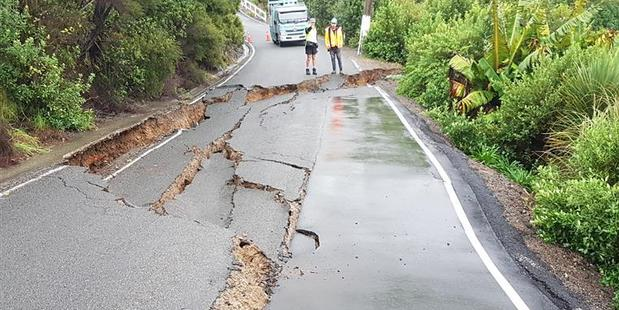 Vehicle access was blocked off and a house was condemned after a 20m section of road slumped. Photo/Supplied
