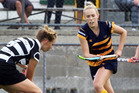 Mangapai's Georgia Beehre pushes the ball under the feet of Old Girls' Jemma Lucas. Photo/Tania Whyte