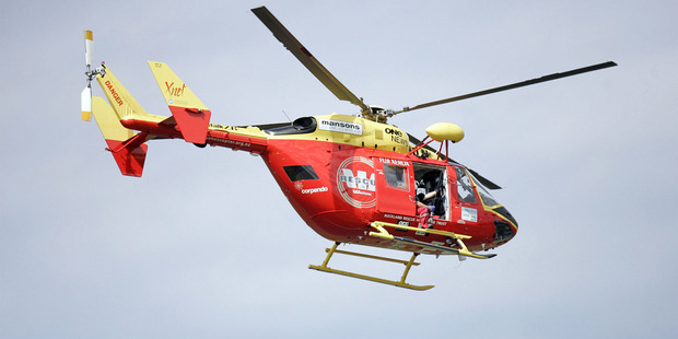 A Westpac rescue chopper is taking a man to hospital after he was hit by a car. Photo/NZHerald