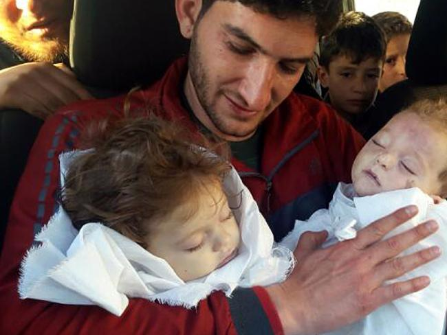 Abdul-Hamid Alyousef holds his twin babies who were killed during the attack, in Khan Sheikhoun and became the face of the global outcry. Photo/AP