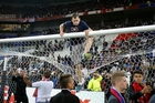 Objects thrown at fans forced some fans on to the pitch and delayed the start of yesterday's Lyon-Besiktas Europa League match. Photo / AP