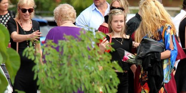 The funeral for Stephanie King, 43, her son Jacob, seven, and daughter Ella Jane, 11, is pictured. The surviving child, Chloe, is pictured at the funeral. Photo / News Corp Australia