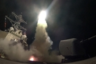 The destroyer USS Porter launches a tomahawk missile at Syria. Photo / AP