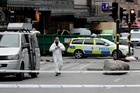 A street is cordoned off following the suspected terror attack in central Stockholm, Sweden. Photo / AP