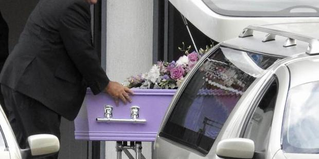 A small, lilac coffin arrives at the funeral. Photo / News Corp Australia