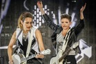 ROCKING: Emily Burns Strayer and Natalie Maines of the Dixie Chicks give it their all at the Mission Concert at Mission Estate Winery in Napier last night. PHOTO/PAUL TAYLOR.