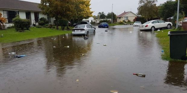 Loading Newstalk ZB's Chris Lynch says the water is overflowing onto roads and lapping at people's driveways although it hasn't reached any houses yet. Photo/Sharlene McCracken