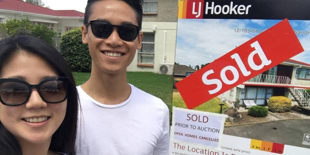 Sarah Kim and Hew Kenn Chew outside their first Auckland property.