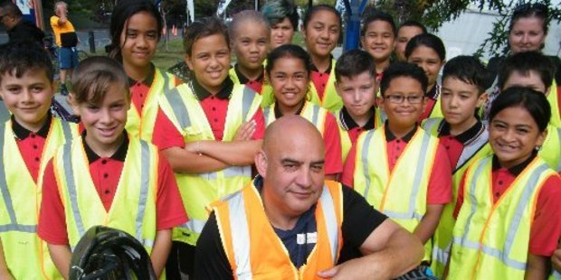 Rhode St School principal Shane Ngatai with pupils who came to enjoy the opening. Photo/Geoff Lewis