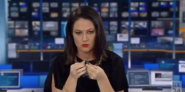 Newsreader's reaction after being caught daydreaming live on-air