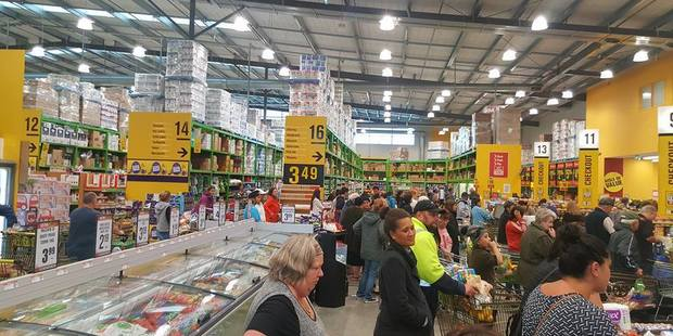 Loading Queues for the check out at Papamoa's Pak n' Save stretch throughout the store as people try to get shopping done before Cyclone Cook hits. Photo/supplied