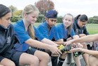 Football players Phoenicia Te Rito (left), Courtney Walker, Jaspreet Singh, Abby Scarborough and Jordan Purcell, of Heretaunga Intermediate, receiving boots last year.