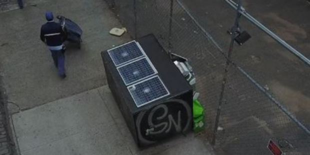 The dumpster is outfitted with wheels, lights, a safety lock, two USB ports, a window and solar panels. Photo / Vimeo / ShaneRDuffy