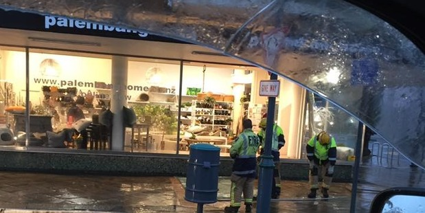 Wind blew the window out of this shop in Gisborne. Photo / Lavinia Kahlia