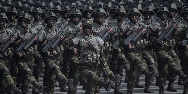Thousands of goose-stepping troops paraded through Pyongyang in a show of strength on Saturday. Photo/Getty Images
