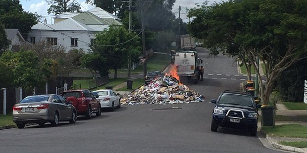 The flaming pile of rubbish (pictured) caught fire after burning embers were mistakenly placed in the back. Photo/Twitter