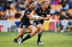 Off-contract Warriors playmaker Kieran Foran runs to the line with halfback Shaun Johnson in support. Photo / Photosport.