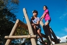 8 year old twins Jaya and Ila Patel gathered 210 signatures on a petition to reinstate monkey bars in the playground at Grey Lynn Park