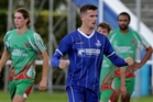 Blues striker Angus Kilkolly celebrates his first of a hattrick of goals as Wairarapa United's midfield maestro Paul Ifill (right) watches at Park Island, Napier, yesterday. Photo /Duncan Brown