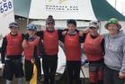 Murrays Bay No 1 team Seb Menzies (left), Mason Mulcahy, Greta Pilkington, James Barnett, Thomas Mulcahy and coach Susannah Pyatt after winning the opti nationals team race. PHOTO/SUPPLIED