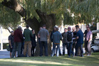 A group of 18-20 plain clothed Police and security outside reception at Millbrook Resort, Arrowtown, near Queenstown. Photo / Brett Phibbs